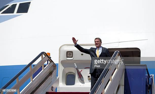 S Defense Secretary Ash Carter waves as he boards his E4B military aircraft at King Abdulaziz International Airport on July 22 2015 in Jedda Saudi...