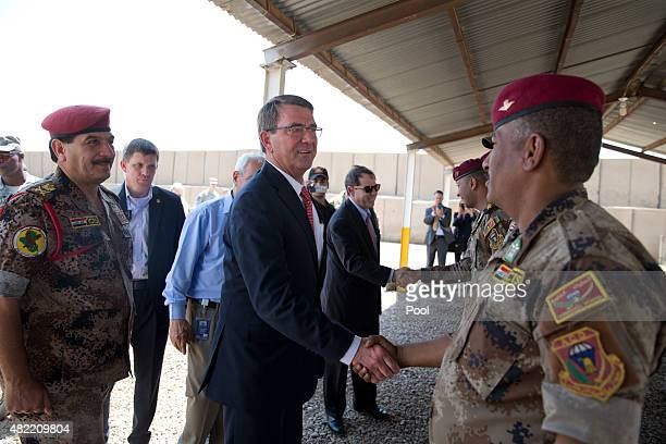 S Defense Secretary Ash Carter with Iraqi Major General Falah al Mohamedawi left greets Iraqi military as he arrives to observe Iraqi Counter...
