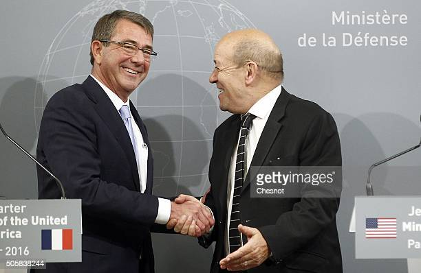 S Defense Secretary Ashton Carter shakes hand with French Defense Minister JeanYves Le Drian after a joint press conference at the French Defense...