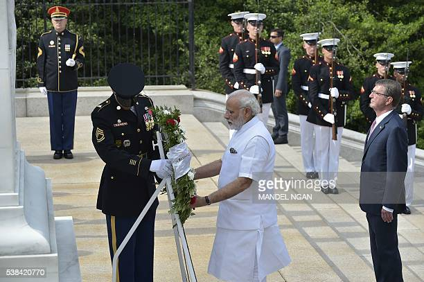 Defense Secretary Ashton Carter takes part in a wreath-laying ceremony with India's Prime Minister Narendra Modi at the Tomb of the Unknown Soldier...