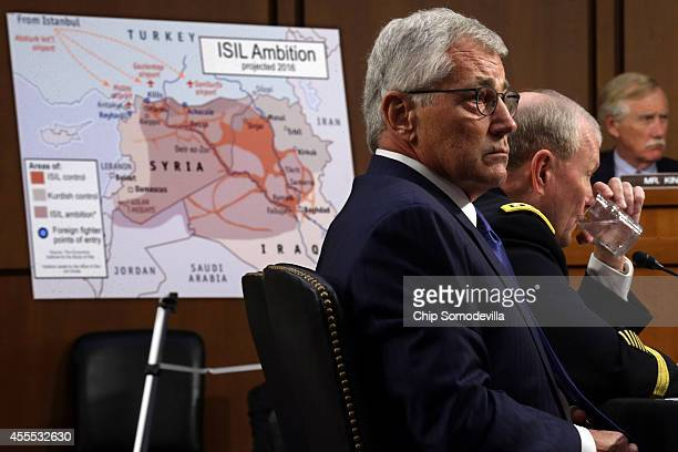 S Defense Secretary Chuck Hagel and Chairman of the Joint Chiefs of Staff Army Gen Martin Dempsey testify before the Senate Armed Services Committee...
