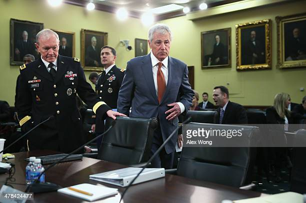 S Defense Secretary Chuck Hagel and Chairman of the Joint Chiefs of Staff Gen Martin Dempsey arrive at a hearing before the Defense Subcommittee of...
