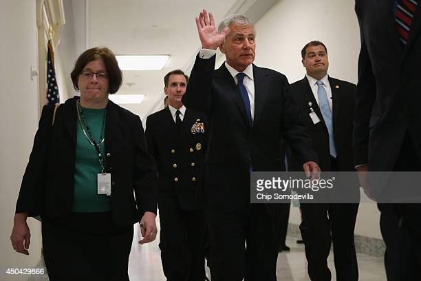 Defense Secretary Chuck Hagel arrives before testifying to the House Armed Services Committee about the about the prisoner exchange that freed Army...