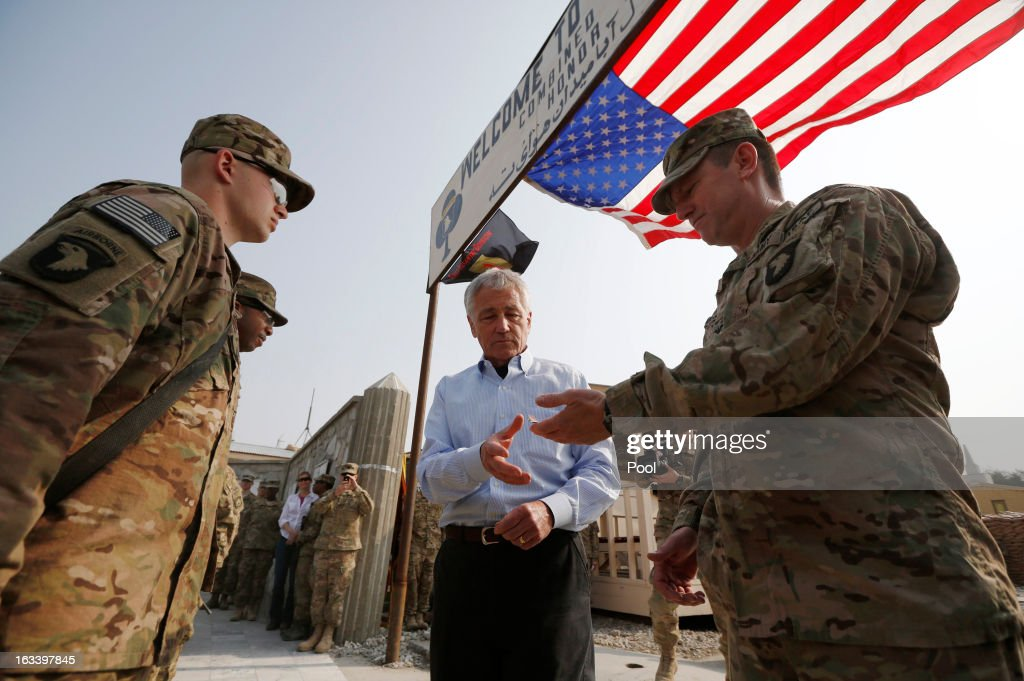 US Defense Secretary Chuck Hagel awards the Purple Heart medal to Army Private Harry Hikes (L) and Sergeant Jeremyah Williams of the 426 Brigade Support Battalion at Jalalabad Airfield on March 9, 2013 near the southeast of Jalalabad city, Afghanistan. Hagel is on his first official trip since being sworn in as US President Obama's Defense Secretary.