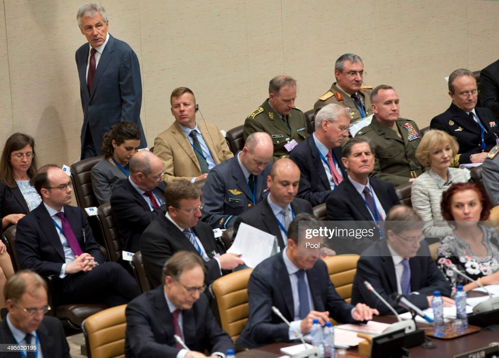 U.S. Defense Secretary Chuck Hagel, background left, arrives for a meeting of NATO defense ministers in the format of the North Atlantic Council with Non-ISAF contributing Nations, at NATO headquarters on June 4, 2014 in Brussels, Belgium. NATO defense ministers met with their Georgian counterparts on Wednesday to discuss security and cooperation issues.
