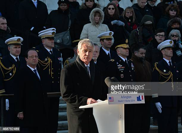 US Defense Secretary Chuck Hagel delivers remarks after French President Francois Hollande laid a wreath at the Tomb of the Unknown at Arlington...
