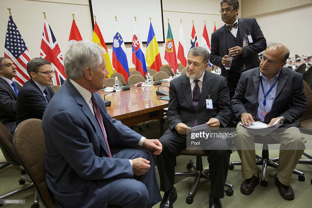 U.S. Defense Secretary Chuck Hagel, left, Afghanistan's Defense Minister Bismillah Khan Mohammadi, second right, and members of their delegations, sit, during a joint meeting on June 4, 2014 in Brussels, Belgium. NATO defense ministers met with their Georgian counterparts on Wednesday to discuss security and cooperation issues.