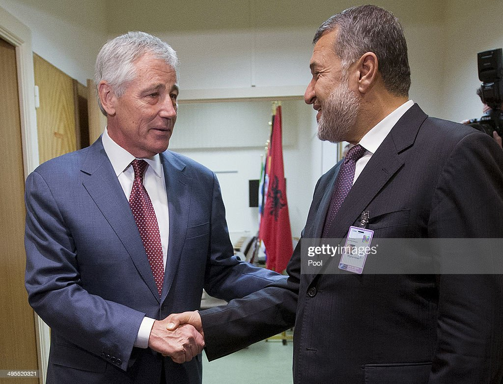 U.S. Defense Secretary Chuck Hagel, left, shakes hands with Afghanistan's Defense Minister Bismillah Khan Mohammadi, right, ahead of their North Atlantic Council (NAT) meeting on June 4, 2014 in Brussels, Belgium. NATO defense ministers met with their Georgian counterparts on Wednesday to discuss security and cooperation issues.