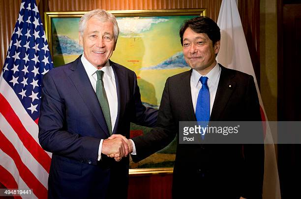 S Defense Secretary Chuck Hagel left shakes hands with Japanese Defense Minister Itsunori Onodera before the start of their meeting on May 31 2014 in...