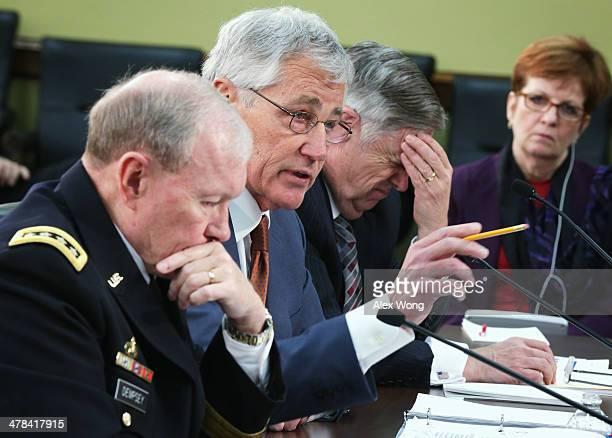 S Defense Secretary Chuck Hagel speaks as Chairman of the Joint Chiefs of Staff Gen Martin Dempsey and Defense Undersecretary/Comptroller Robert Hale...
