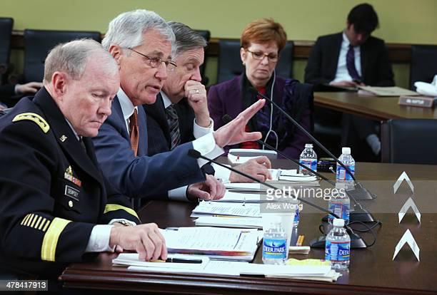 S Defense Secretary Chuck Hagel spseaks as Chairman of the Joint Chiefs of Staff Gen Martin Dempsey and Defense Undersecretary/Comptroller Robert...