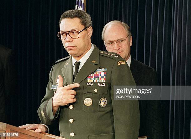 Defense Secretary Dick Cheney stands by as General Colin Powell, chairman of the Joint Chiefs of Staff, briefs reporters at the Pentagon 20 December...