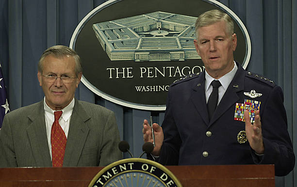 US Defense Secretary Donald Rumsfeld (L) looks on Pictures | Getty