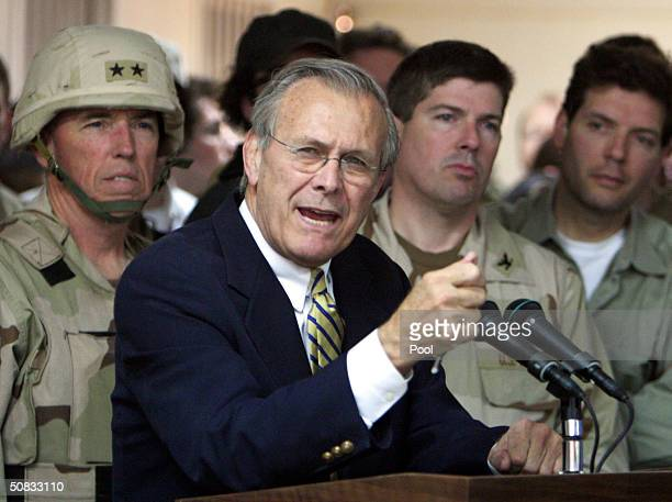 S Defense Secretary Donald Rumsfeld speaks to military personnel at the Abu Ghraib Prison May 13 2004 on the outskirts of Baghdad Iraq Rumsfeld made...