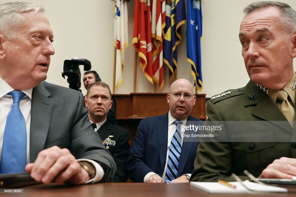 U.S. Defense Secretary James Mattis (L) and Chairman of the Joint Chiefs of Staff Gen. Joseph Dunford prepare to testify before the House Armed Services Committee in the Rayburn House Office Building on Capitol Hill April 12, 2018 in Washington, DC. The Trump administration's top war-fighters, Mattis and Dunford faced questions about their FY2019 defense budget request, the possible military response to alleged chemical attacks in Syria and other subjects.