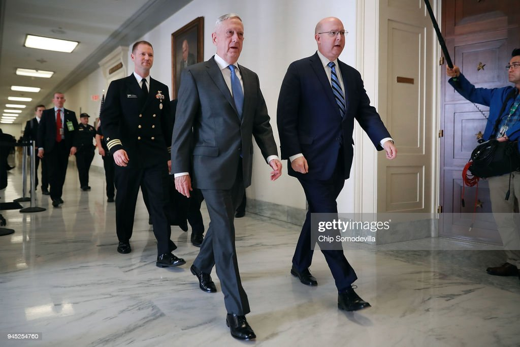 U.S. Defense Secretary James Mattis (C) arrives at the Rayburn House Office Building before testifying to the House Armed Services Committee on Capitol Hill April 12, 2018 in Washington, DC. Mattis and Chairman of the Joint Chiefs of Staff Gen. Joseph Dunford are scheduled to testify about their FY2019 defense budget request.