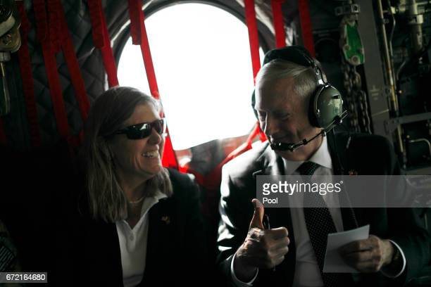 S Defense Secretary James Mattis gives senior advisor Sally Donnelly a thumbsup as they discuss their schedule upon arriving via helicopter at...