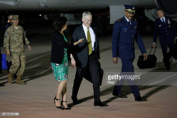 S Defense Secretary James Mattis is greeted by US Ambassador to Qatar Dana Shell Smith and Qatar Ministry of Defense Director of International...