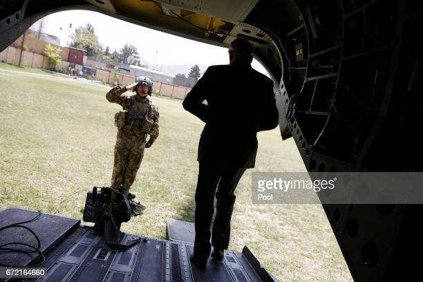 S Defense Secretary James Mattis is saluted by a member of his US Army helicopter crew as he arrives at Resolute Support headquarters on April 24...