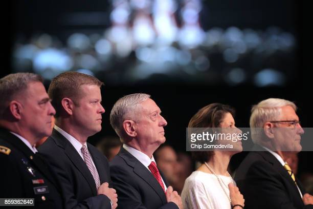 S Defense Secretary James Mattis listens to the national anthem before delivering the keynote address during the Association of the United States...