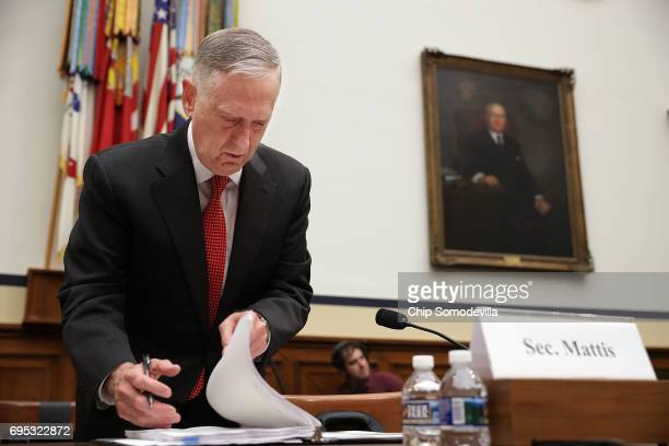 S Defense Secretary James Mattis looks over his notes before testifying to the House Armed Services Committee during a hearing in the Rayburn House...