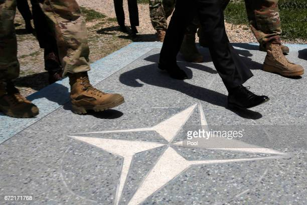S Defense Secretary James Mattis walks with US Army leaders across a NATO logo as he arrives at Resolute Support headquarters on April 24 2017 in in...