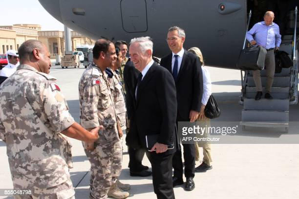 US Defense Secretary Jim Mattis and NATO Secretary General Jens Stoltenberg are greeted by US and Qatari military officials upon their arrival at...