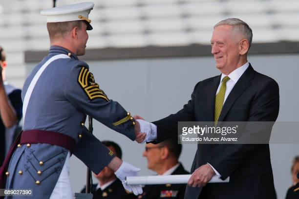 Defense Secretary Jim Mattis presents a diploma during the U.S. Military Academy Class of 2017 graduation ceremony at Michie Stadium on May 27, 2017...