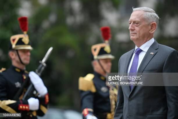 US Defense Secretary Jim Mattis reviews a guard of honour upon his arrival for an official meeting with French Defence Minister at the French Defence...