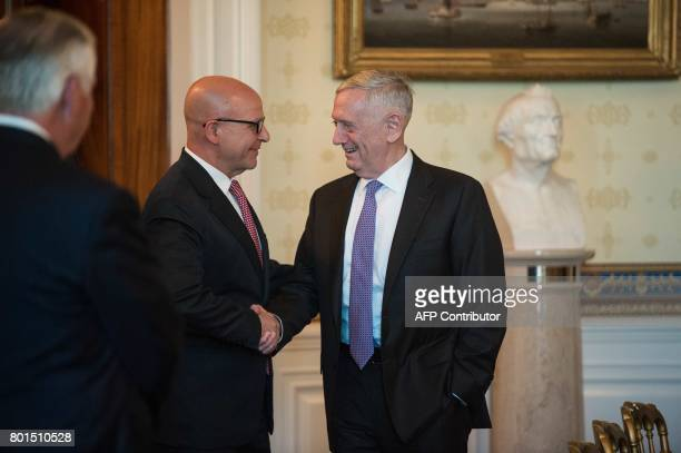US Defense Secretary Jim Mattis shakes hands with National Security Adviser HR McMaster as they arrive to attend odinner with Indian Prime Minister...