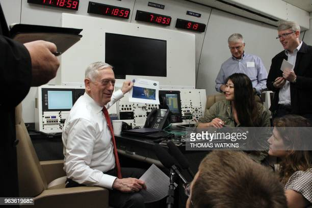 US Defense Secretary Jim Mattis speaks to reporters as he shows the plane's route to Hawaii aboard a US military plane on May 29 2018 Mattis vowed...