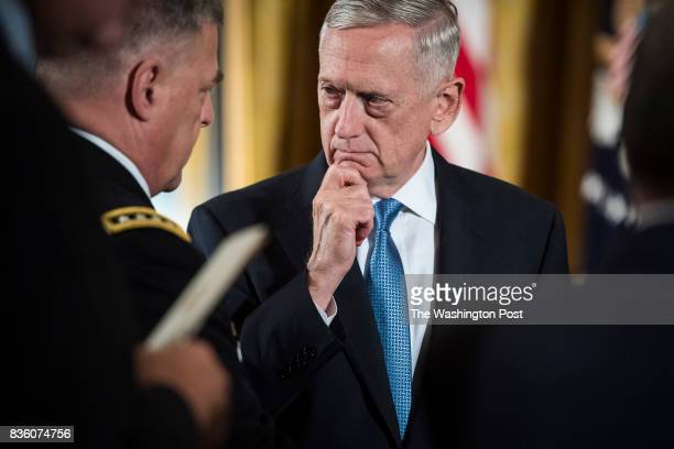Defense Secretary Jim Mattis talks with Chief of Staff of the Army Gen Mark A Milley left before President Donald Trump bestows the nation's highest...