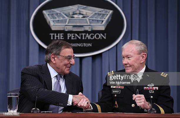 S Defense Secretary Leon Panetta and Chairman of the Joint Chiefs of Staff General Martin Dempsey shake hands after signing orders that will lift a...
