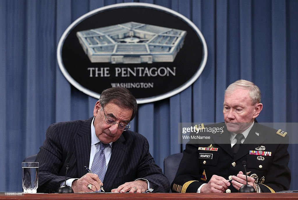 U.S. Defense Secretary Leon Panetta (L) and Chairman of the Joint Chiefs of Staff General Martin Dempsey sign orders that will lift the ban on women in combat positions within the U.S. military at the Pentagon January 24, 2013 in Arlington, Virginia. The U.S. Army and the Marine Corps will present plans to open most combat occupations to women by May 15.