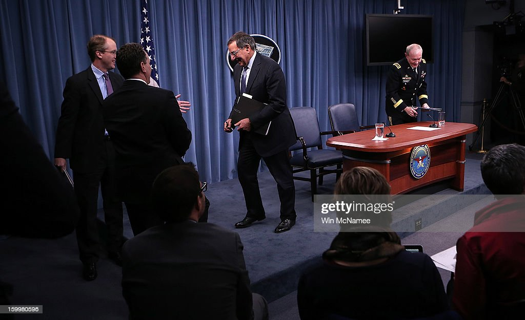 U.S. Defense Secretary Leon Panetta (2R) and Chairman of the Joint Chiefs of Staff General Martin Dempsey (R) depart a ceremony where they signed orders that will lift the ban on women in combat positions within the U.S. military at the Pentagon January 24, 2013 in Arlington, Virginia. The U.S. Army and the Marine Corps will present plans to open most combat occupations to women by May 15.