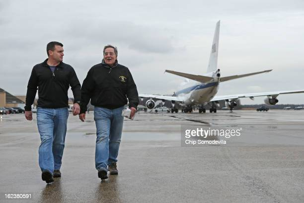S Defense Secretary Leon Panetta and his military assistant Navy Commander Larry Getz walk across the tarmac and away from the E4B aircraft after...
