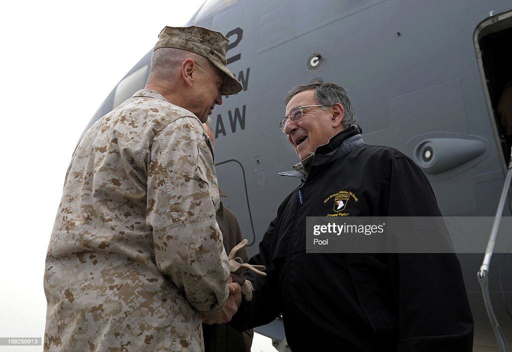 Defense Secretary Leon Panetta (R) is greeted by Marine Gen. John R. Allen (L) commander of International Security Assistance Force, upon his arrival at Kabul International Airport on December 12, 2012 in Kabul, Afghanistan. The Defense Secretary met with troops to thank them for their service during a four day visit to Kuwait .
