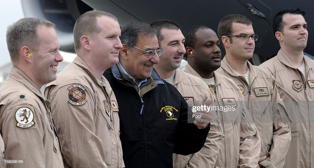 US Defense Secretary Leon Panetta (C) poses with US troops at Kabul International Airport before boarding his plane to return to Washington, on December 14, 2012 in Kabul, Afghanistan. Following the US Defense Secretary's meeting with Afghan president Hamid Karzai and top Afghan officials during his three-day visit to Afghanistan, Secretary Panetta met with US troops and commanders, as the US looks towards a decision on troop numbers once the US-led coalition ends in late 2014.
