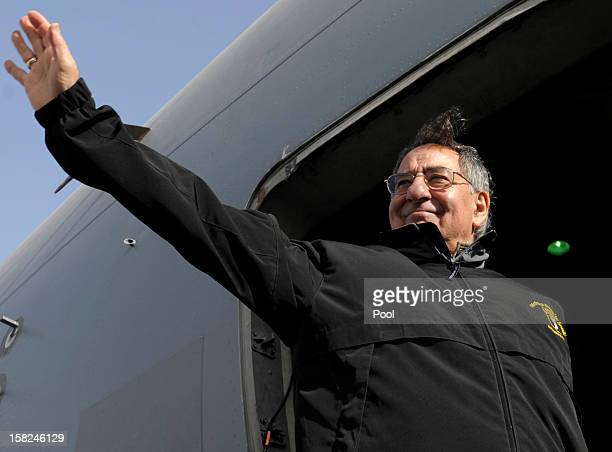 Defense Secretary Leon Panetta waves as he boards his plane after visiting troops at Ali Al Salem Air Base on December 12 2012 in Kuwait The Defense...