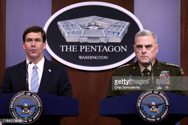 Defense Secretary Mark Esper and Chairman of the Joint Chiefs of Staff Gen. Mark Milley hold a news conference at the Pentagon the day after it was...