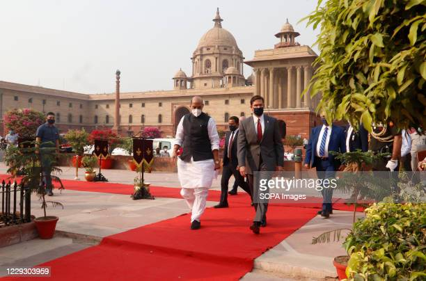 Defense Secretary Mark Esper and Indian Defence Minister, Rajnath Singh wearing face masks review a joint military guard of honour during a...