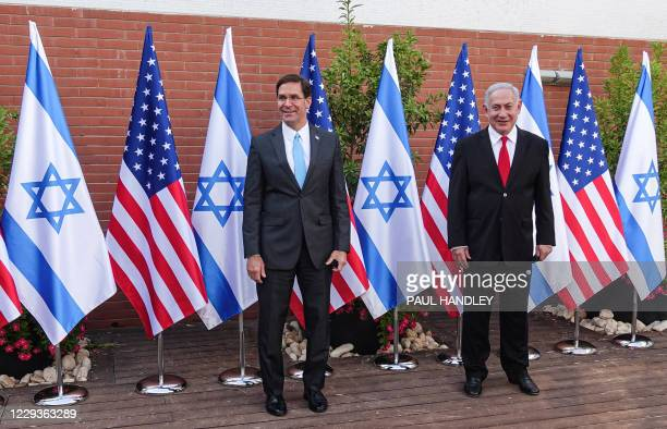 Defense Secretary Mark Esper and Israeli Prime Minister Benjamin Netanyahu pose for a picture together as they meet at the Israel Aerospace...