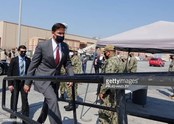 Defense Secretary Mark Esper boards on October 28, 2020 the USS Devastator minesweeper while on a visit to the Naval Forces Central Command base in...