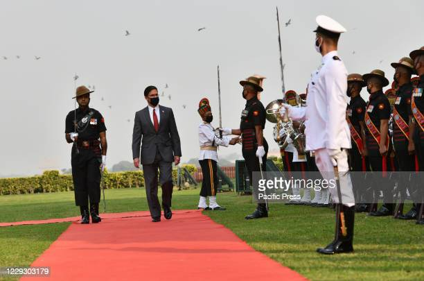 Defense Secretary Mark Esper inspects a guard of honor at the Defense Ministry in New Delhi.