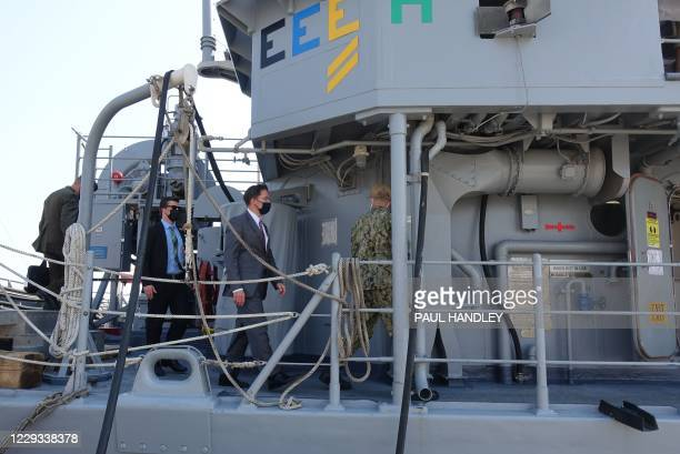 Defense Secretary Mark Esper is pictured on October 28, 2020 aboard the USS Devastator minesweeper while on a visit to the Naval Forces Central...