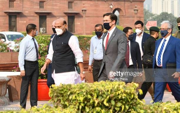Defense Secretary Mark Esper, is seen with his Indian counterpart Rajnath Singh as he arrives at the Defense Ministry for a ceremonial guard of honor...