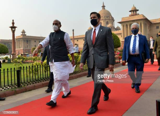 Defense Secretary Mark Esper , is welcomed by his Indian counterpart Rajnath Singh as he arrives at the Defense Ministry for a ceremonial guard of...