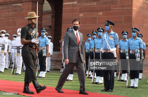 Defense Secretary Mark Esper wearing a face mask reviews a joint military guard of honour during a ceremonial reception at the Defence Ministry of...