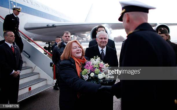 S Defense Secretary Robert Gates and his wife Becky are greeted upon their arrival in St Petersburg Russia Monday March 21 2011 US and coalition...