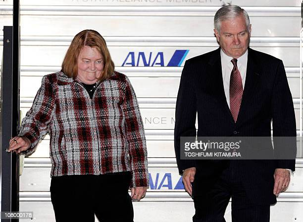 US Defense Secretary Robert Gates and his wife Becky arrive at Haneda International Airport in Tokyo on January 12 2011 Gates earlier in the day...